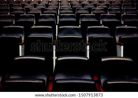 Rows of empty seats and seats in an auditorium. #1507913873