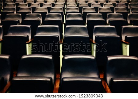 Rows of empty seats and seats in an auditorium. #1523809043