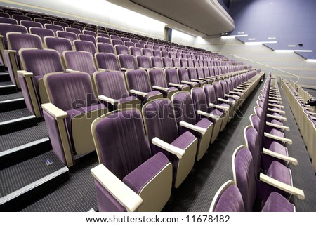 rows of empty seats interior perspective pattern