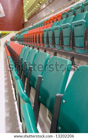 Rows of folded spectator chairs at an International sport venue in Doha, Qatar. Possible venue for the 2016 Olympic Games. Shallow DOF.