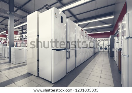 Rows of fridges and washing mashines in appliance store
