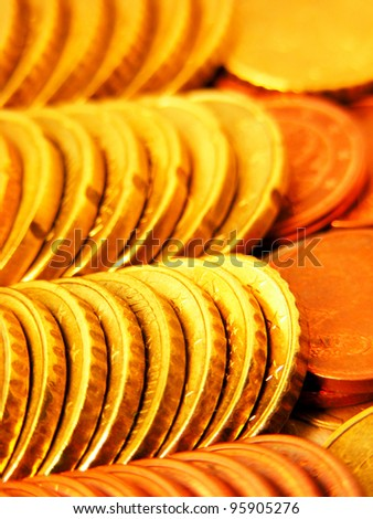 Rows of gold coins. Selective focus.