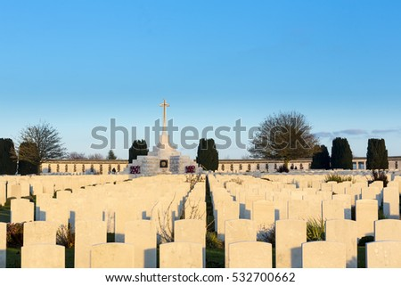 Rows of Gravestones at Tyne Cot World War One Cemetery, the largest British War cemetery in the world.  near Ypres, Flanders, Zonnebeke, Belgium. Photo taken at Sunset in the Golden Hour. Stock photo ©