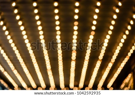 Rows of illuminated globes under the marquee as often used at entrance to theatres and casinos #1042592935