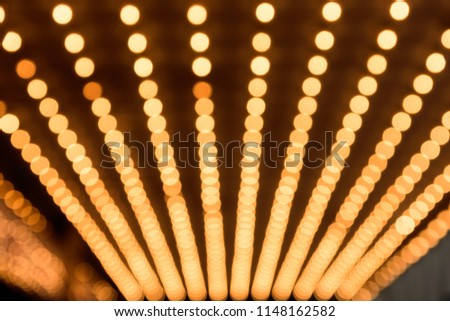 Rows of illuminated globes under the marquee as often used at entrance to theatres and casinos #1148162582