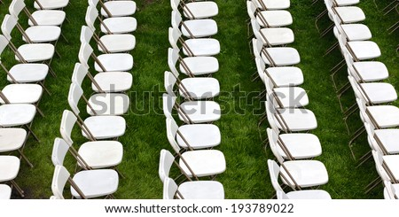 Rows of lawn chairs await the crowds before college graduation ceremonies at a major U.S. university.