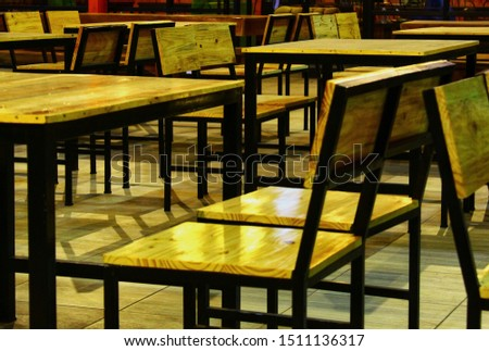rows of minimalist chairs and minimalist tables