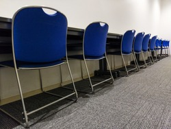 Rows of modern chairs and table lined up. Seat for study. Education Concept