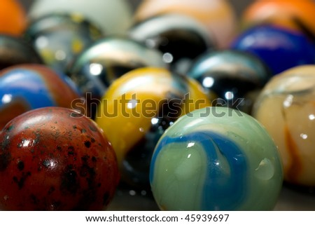 Rows of muliti colored marbles wet with water