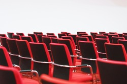 Rows of red chairs arranged in the main conference room.