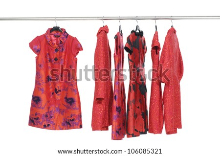 Rows of red evening gown on a clothesline