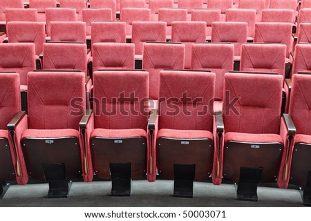 Rows of red folding chairs in conference room #50003071