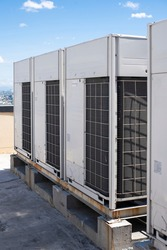 Rows of rooftop HVACs on the roof deck of an office tower. VRF air conditioner for commercial buildings