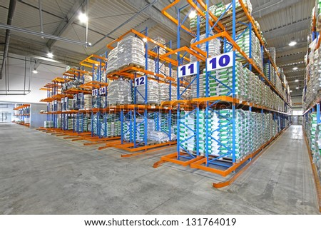 Rows of shelving system in distribution warehouse