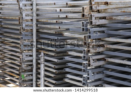 Rows of steel bar storage and stacking in the warehouse for industrial construction. Stack of metal pipes #1414299518