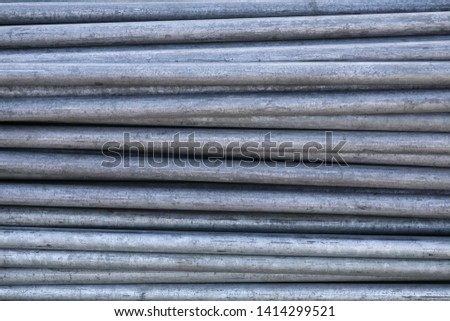 Rows of steel bar storage and stacking in the warehouse for industrial construction. Stack of metal pipes #1414299521