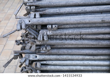 Rows of steel bar storage and stacking in the warehouse for industrial construction. Stack of metal pipes #1415534933