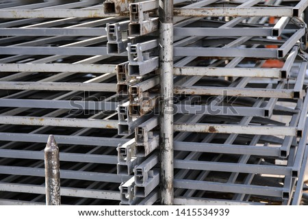 Rows of steel bar storage and stacking in the warehouse for industrial construction. Stack of metal pipes #1415534939