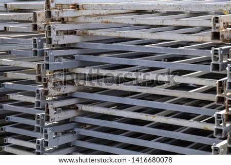 Rows of steel bar storage and stacking in the warehouse for industrial construction. Stack of metal pipes #1416680078