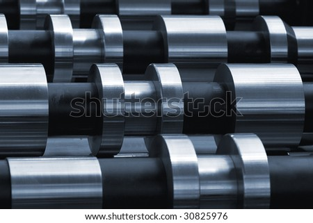 Rows of steel rollers toned in blue.