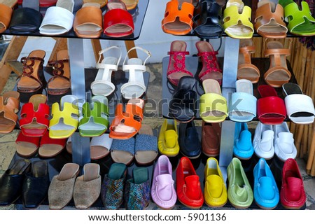 Rows of summer shoes in the shop