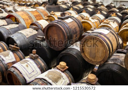 Rows of traditional balsamic vinegar sitting inside oak barrels at different stages of aging Zdjęcia stock ©