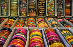 Rows of traditional Indian bangles with different colors and patterns.