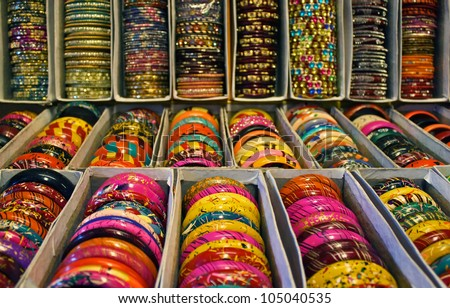 Rows of traditional Indian bangles with different colors and patterns. - stock photo