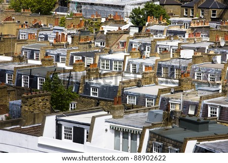 Rows of typical London terraced housing rooftops