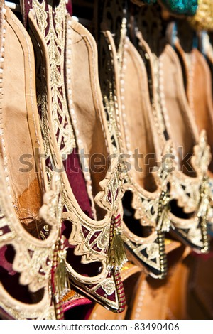 Rows of typically oriental shoes at the market in Dubai, shallow DOF.