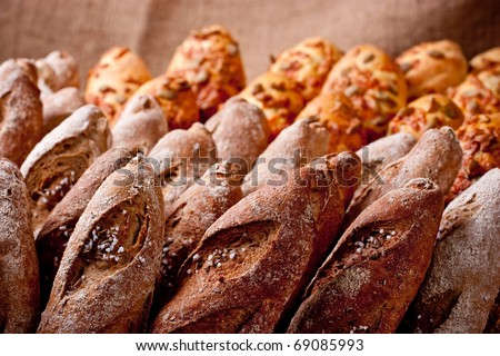 Rows of various bakery products close up on brown background