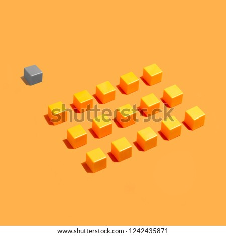 Rows of yellow identical cubes and behind gray. Minimal style, concept. Symbolic position of outsider #1242435871