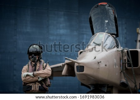 Royal Air force (RAF) Jaguar strike attack fighter jet with pilots wearing flying suits and helmets ready to fly their aeroplanes.  Zdjęcia stock ©
