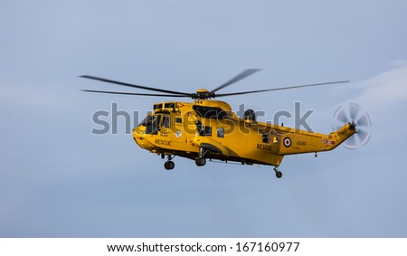 Royal Air Force, Search and Rescue Helicopter from RAF Lossiemouth on a training exercise at Cove Bay, Hopeman, Moray, Scotland, United Kingdom on 9 December 2013.