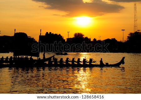 Royal Barge Procession at the Chao Phraya River in Bangkok, Thailand during sunset time