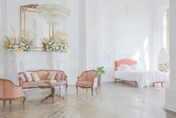 royal baroque style luxury posh interior of large room. extra white, full of day light. high ceiling and walls decorated by stucco