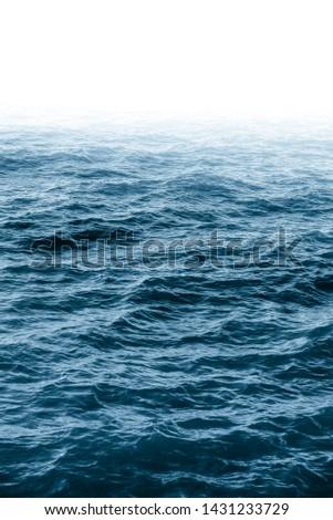 Royal blue atlantic ocean. Deep blue ocean water wave. Navy blue aqua. Mystic fog. Marine landscape. Sea view. Wet surface. Pacific ocean. Aqua background. Blue ocean background.