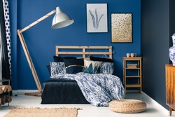 Royal blue bedroom interior with a touch of gold