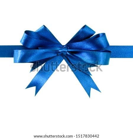 Royal blue gift ribbon bow straight horizontal isolated on white. #1517830442