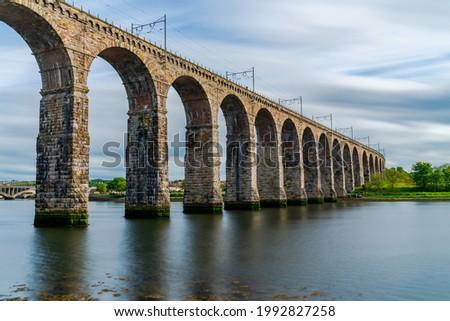 Royal Border Bridge spans the River Tweed between Berwick-upon-Tweed and Tweedmouth in Northumberland, England. Long exposure effect