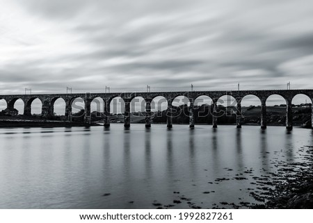 Royal Border Bridge spans the River Tweed between Berwick-upon-Tweed and Tweedmouth in Northumberland, England. Long exposure black and white effect