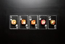 Royal Flush hand drawn Poker cards with sushi roll pieces on chalkboard background. Asian rolls with shrimp, avocado, salmon and flying fish roe. Ten, Jack, Queen, King and Ace of Hearts chalk cards