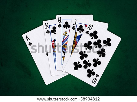 Royal Flush of clubs over a green grungy background
