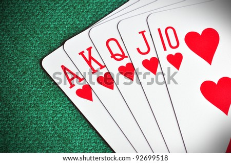 Royal Flush poker card sequence on a green table