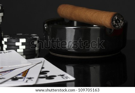 royal flush with poker chips on black background close-up - stock photo