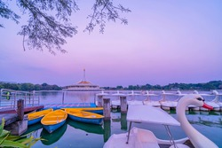 Royal garden Rama IX, Thailand. Twilight Pavilion landmark of Suan Luang Rama IX Public Park, Bangkok, Thailand. Swan-shaped water bike on the lake