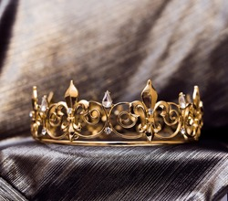 Royal gold crown with fleur de lys elements