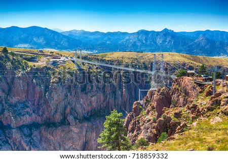 Royal gorge canyon and the associate suspension bridge draw tourists to Colorado. #718859332