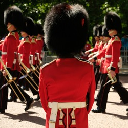 Royal Guards taking part in the traditional Trooping the Colour military ceremony in London  on a sunny day