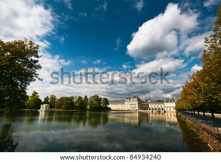 Royal hunting castle Fontainbleau near Paris in France and lake.